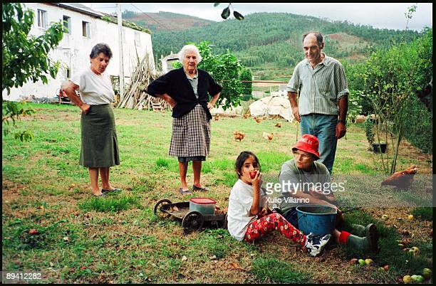 Typical family of galician village in the orchard of your house Foz Lugo Galicia