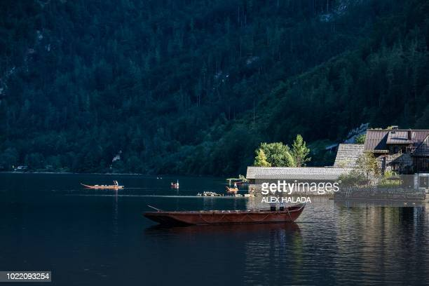A typical flatbottomed boat called Plaette crosses Lake Hallstatt in Austria on August 16 2018 Like for all mines a fresh round of strengthening work...