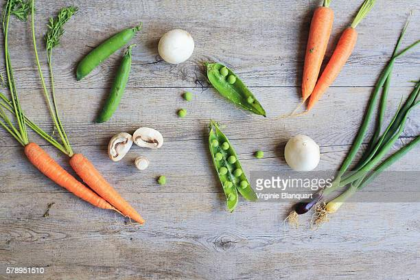 Typical french dish, green peas, carrots, onions and mushrooms