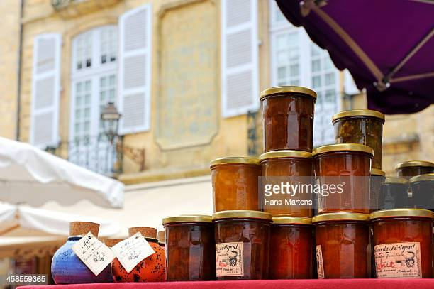 typical french marmalade and honey on sale at a market - sarlat stock photos and pictures