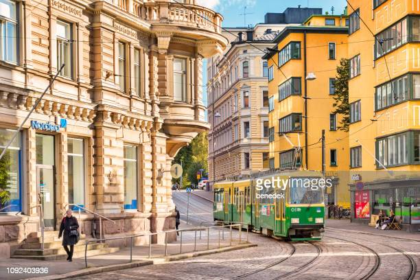 typical green-yellow tram in downtown helsinki finland - helsinki stock pictures, royalty-free photos & images