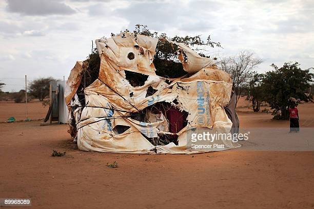 Typical home for a refugee is covered with branches and torn tarps in Dadaab, the world�s biggest refugee camp August 20, 2009 in Dadaab, Kenya. The...