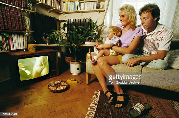 A typical Hungarian family photographed watching porn transmitted on Saturday night TV