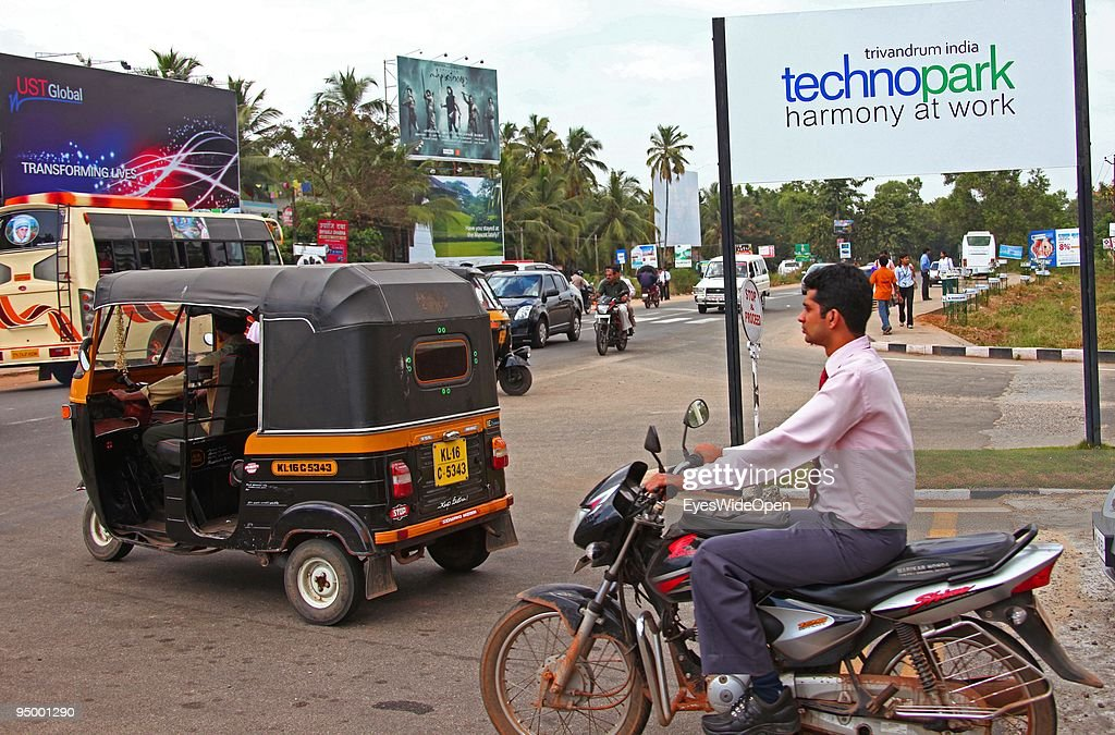 Typical indian motor rikshaw at the center of technology in Kerala called technopark where highly educated women and men working at more then 45 software, hardware and international companies on December 14, 2009 in Trivandrum, South India.