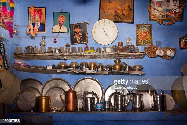 A typical Indian village or small town kitchen displays dishes along with photos of family members and gods and goddesses on March 31 2009 in the...