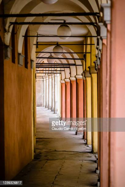 typical italian alley of the city of modena, in the emilia romagna. - modena stock pictures, royalty-free photos & images
