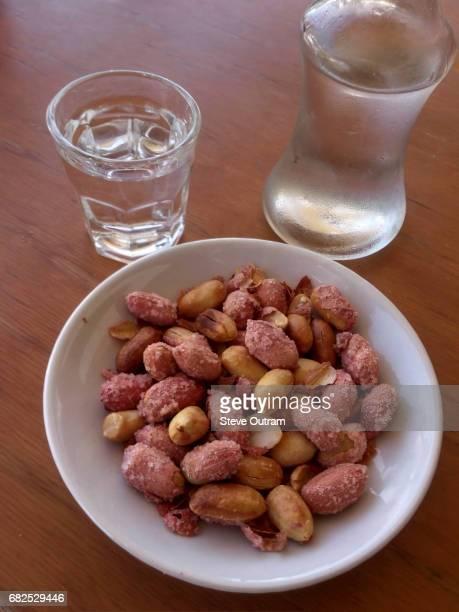 Typical Kafeneio Meze and drink of Tsikoudia Raki Crete, Greece