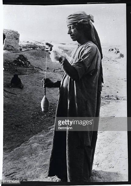 A typical Kurdish villager is shown in Iran as he spins wool by this ancient method