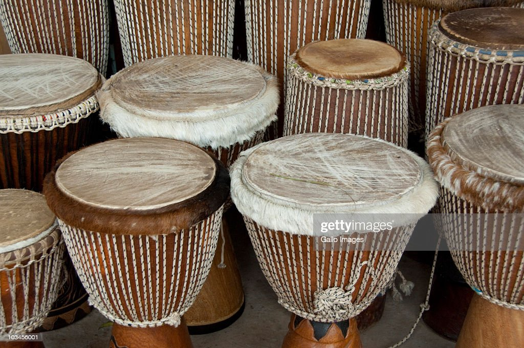 Typical leather covered wooden drums, called djembe, Banjul, Gambia : Foto de stock
