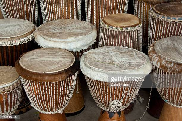 typical leather covered wooden drums, called djembe, banjul, gambia - áfrica del oeste fotografías e imágenes de stock