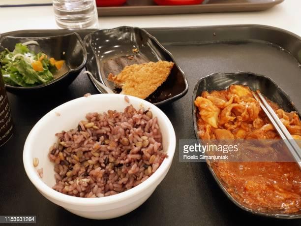 typical lunch set in a university cafeteria in south korea - yōshoku imagens e fotografias de stock