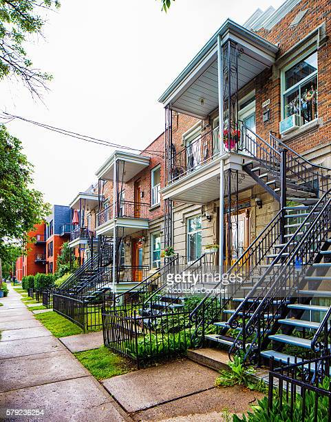 typical montreal rosemont area townhouses with exterior stairways - montreal stock pictures, royalty-free photos & images