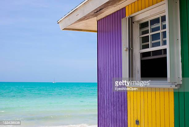 Typical multi-coloured bahamian wood house at the beach of the turquoise carribean sea on June 15, 2012 in Cat Island, The Bahamas.
