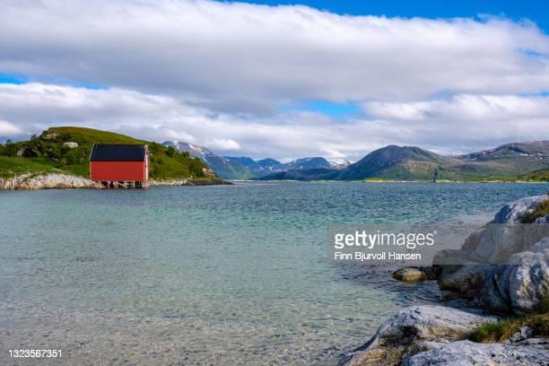 typical norwegian rorbu at sommarøy in northern norway - finn bjurvoll stock-fotos und bilder