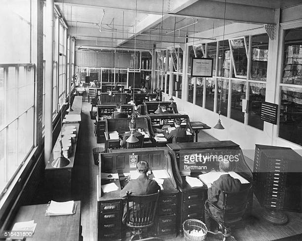 Typical office of the early 1900's showing rollup desks lined up Photograph BPA2# 3394