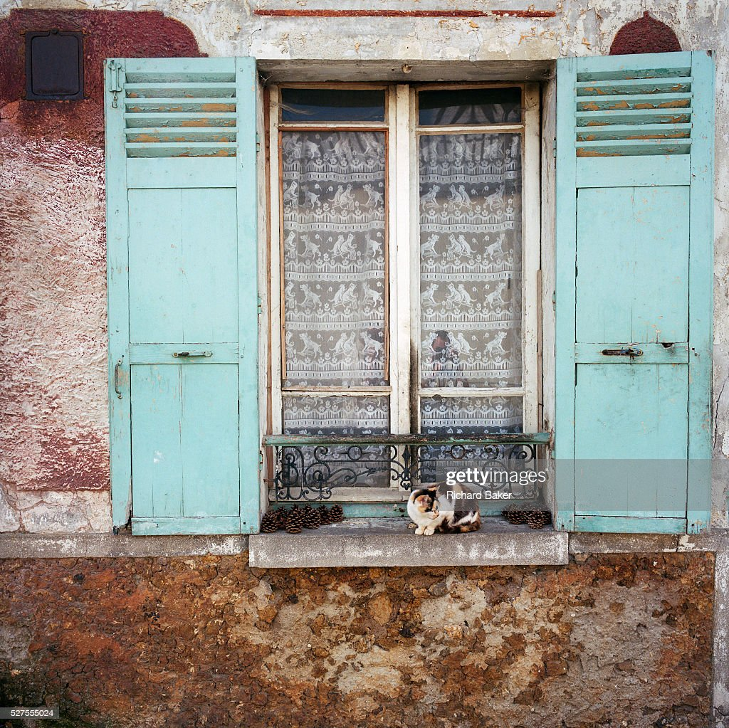 A Typical Old French House Window And Shutters With A
