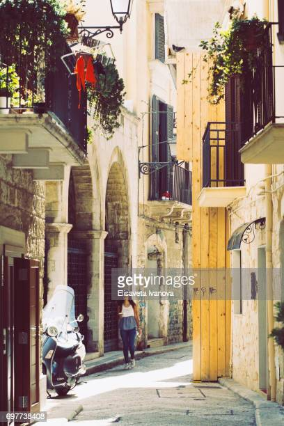typical old town street, bari, italy - bari stock photos and pictures