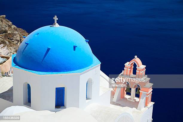typical orthodox greek church in oia, santorini. greece - caldera stock pictures, royalty-free photos & images