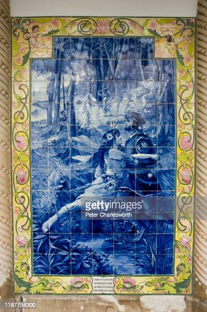 Typical Portuguese fresco, made from traditional blue and white ceramic tiles, depicts a love scene on a wall in the outside colonnade of the Bussaco...