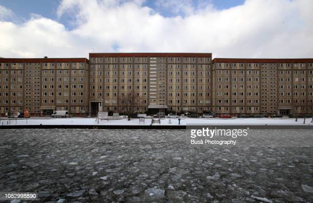 typical prefabricated concrete slab building (plattenbau) overseeing the spree river in berlin, germany - east germany stock pictures, royalty-free photos & images