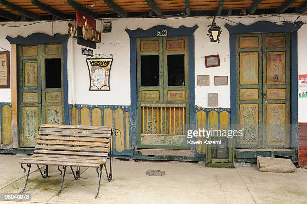 Typical Quindio style colorful wooden houses on the main street Salento Salento is a small town in the hills near the city of Pereira It is known for...