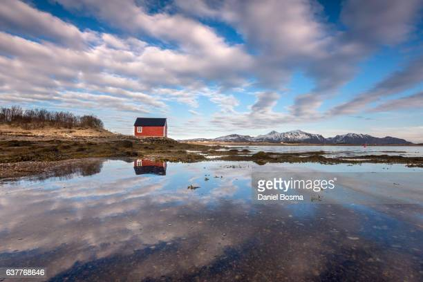 Typical red boathouse in spectacular Norwegian landscape