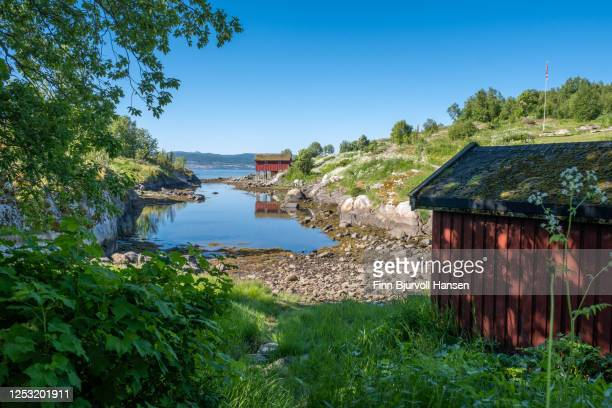 typical red boathouse located at saltstraumen near bodø in northern norway - finn bjurvoll stock pictures, royalty-free photos & images