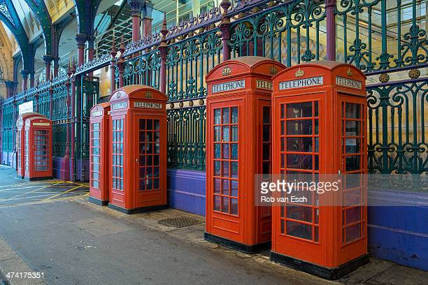 CONTENT] Typical red phone booths in a row on smithfields market or London Central Markets the largest wholesale meat market in the UK and one of the...