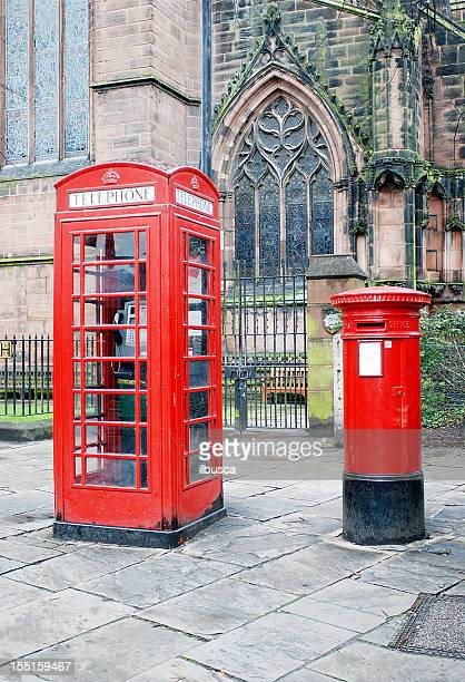 typical red telephone booth and postbox in england - red telephone box stock pictures, royalty-free photos & images