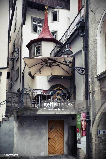 typical roof and balcony of a building in old town , lucerne. - emreturanphoto stock pictures, royalty-free photos & images