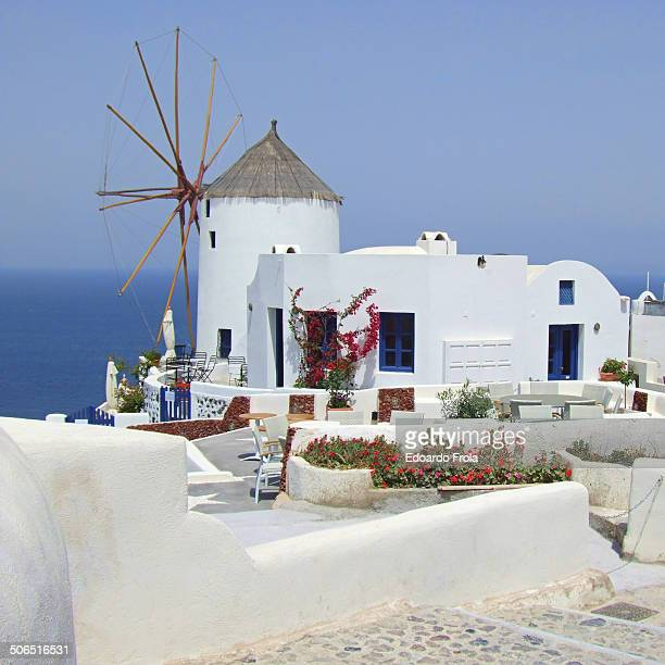 CONTENT] Typical Santorini island landscape with old wooden windmills and sea Oia Village Santorini Island Greece