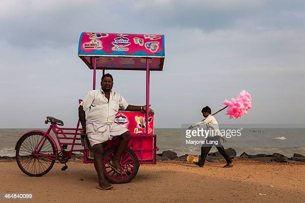 Typical scene with ice cream and cotton candy sellers by the sea in Pondicherry, Union territory enclave in Tamil Nadu, India.