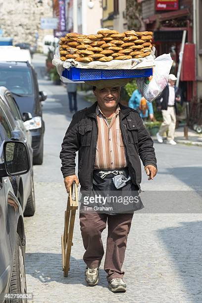 Typical Simitci Turkish man selling simit turkish sesame bread rings in streets of Istanbul Republic of Turkey