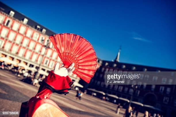 typical spanish fan with the plaza mayor in the background - cultura española fotografías e imágenes de stock
