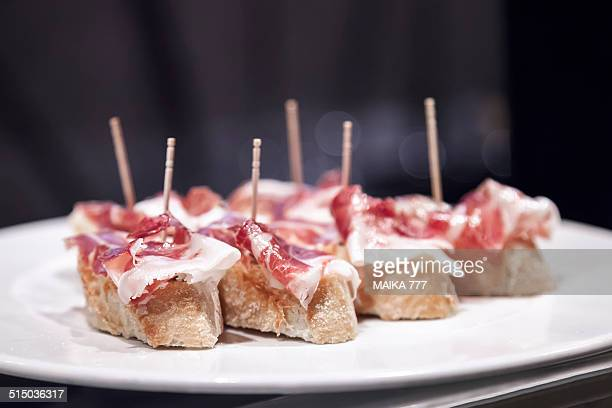 Typical spanish Tapa,Pincho or Pintxo of cured ham