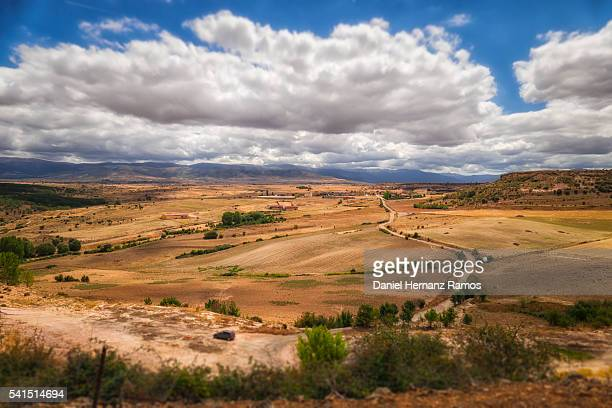 typical spanish view of a plowed wheat field sunny daylight in summer - castilla leon fotografías e imágenes de stock