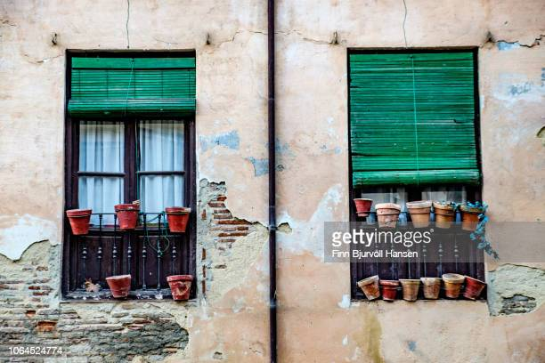 typical spanish windows in the city of old granada spain - finn bjurvoll stock photos and pictures