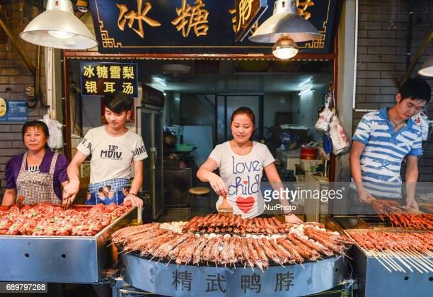 A typical stand/small street restaurant with Chinese cuisine specialities for sale seen in Flavor Street a local food street in Wuhan center On...