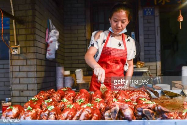 A typical stand/small street shop with Chinese cuisine specialities on display for sale seen in Flavor Street a local food street in Wuhan center On...