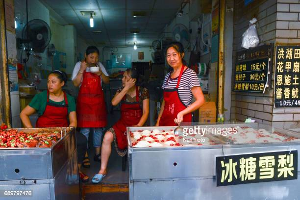 A typical stand/small street shoprestaurant with Chinese cuisine specialities on display for sale seen in Flavor Street a local food street in Wuhan...