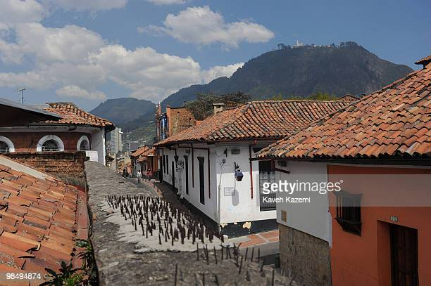 A typical street in Candeleria old part of Bogota Bogota formerly called Santa Fe de Bogota is the capital city of Colombia as well as the most...