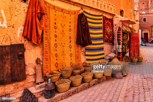 typical street in the medina district of marrakech, morocco - djemma el fna square stock photos and pictures