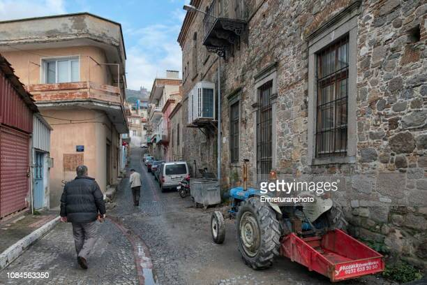 typical street view with pedestrians and parked tractor - emreturanphoto stock pictures, royalty-free photos & images
