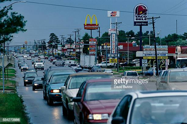 A typical strip of highway businesses including signs for McDonalds and Taco Bell fast food restaurants along US Highway 412 in Springdale a town...