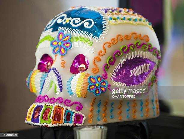 A typical sugar Calaverita is seen in an Altar of the Dead at the Soumaya museum in Mexico City on October 30 2009 Mexicans celebrate the Day of the...