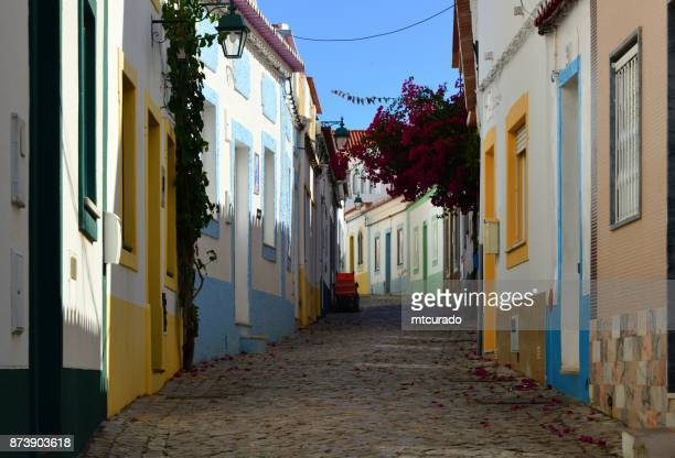typical tortuous street of ferragudo, algarve, portugal - faro stock photos and pictures