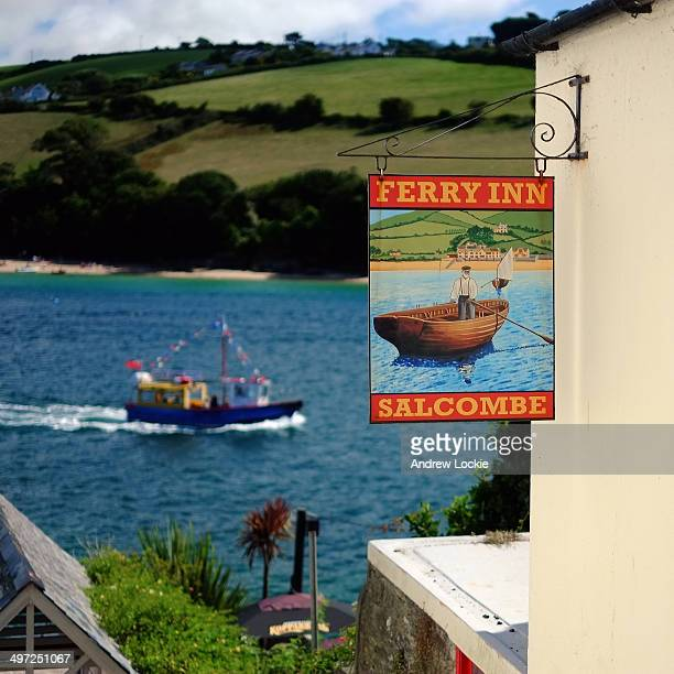 CONTENT] Typical tourist view of Salcombe with Ferry Inn sign and estuary beyond Image taken at Salcombe in Devon England