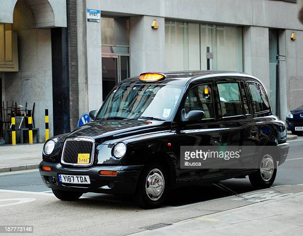 Typical traditional british taxi cab in the streets of Liverpool
