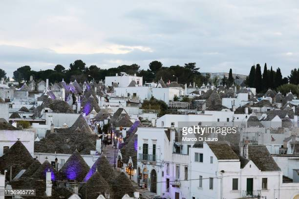 Typical Trulli of Alberobello are seen on April 10 2019 in Alberobello taly Climate change extreme weather and Xylella fastidiosa a bacteria...