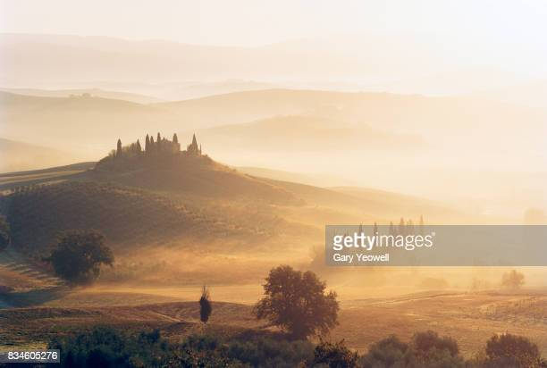 Typical Tuscany landscape with farmhouse in the mist